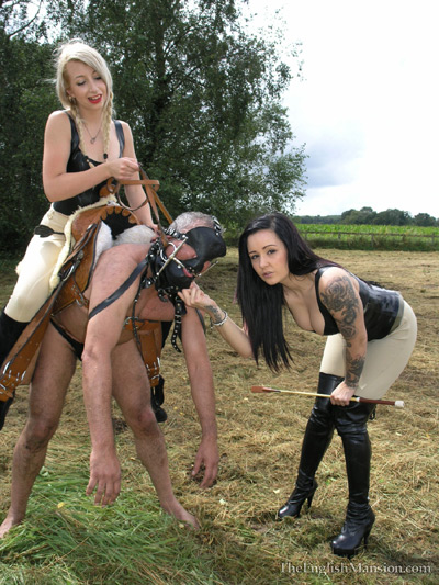 Young Dommes abusing their pony on the field