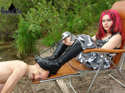 Crushing the slave under her boots