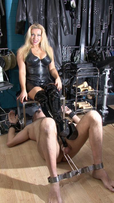 Mistress Alexandra cock tortures her slave with her boot heels