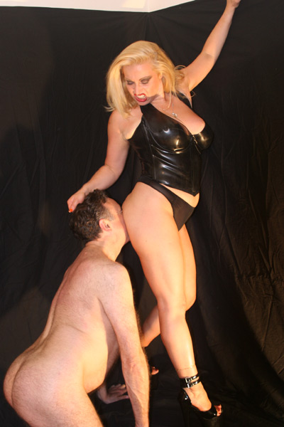 Overpowering her slave and making him worship her ass