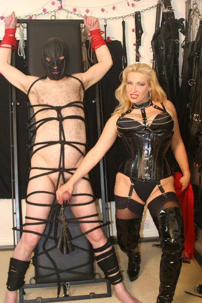 Milking the hog tied slave in the dungeon