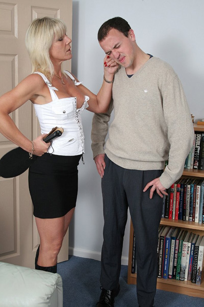 Pulling on the ears of the naughty slave
