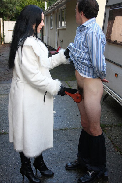 Mistress strips her slave naked in the public