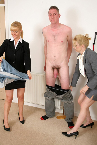 2 Ladies stripping the slave naked to examine him