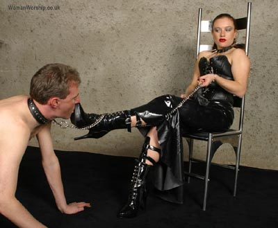 Leashed slave worships Mistress's boots