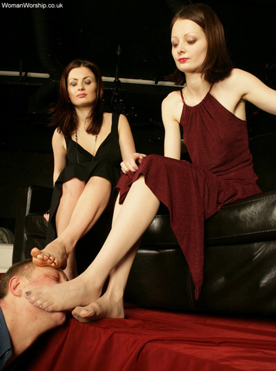 Rubbing their stockings feet all over the foot slave