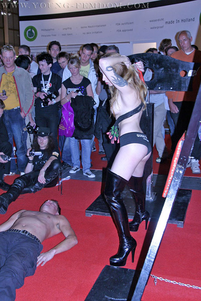 A slave submits to Mistress in the public for trampling