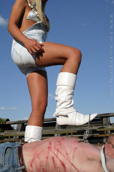Tip of her boots to pull on the nipple clamps