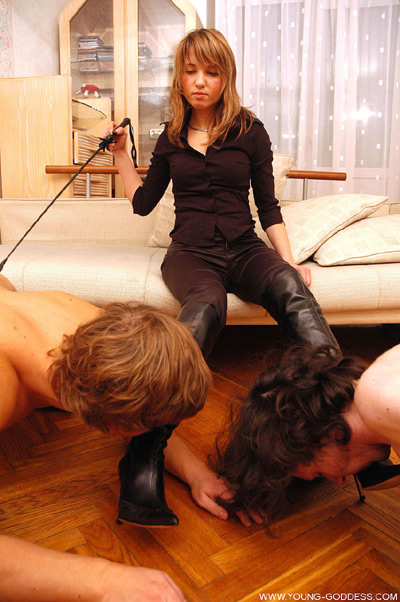 Mistress Olga has no lack of slaves to clean her boots